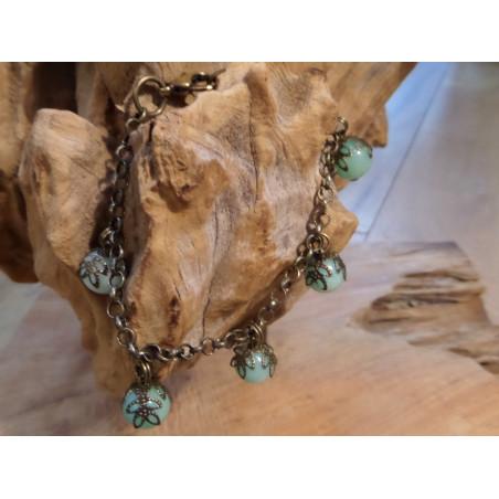 armbamd van brons met half-edelstenen